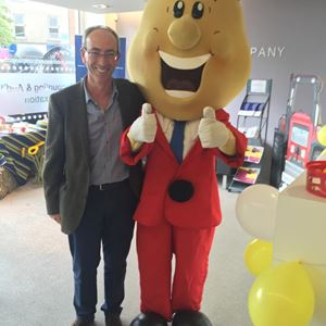 Partner Michael Gibson meets Mr Tayto at the Robinson & Company office.jpg