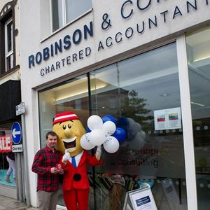 Robinson & Company's Stuart McDonald with Mr Tayto as the office opens for Country Comes to Town.jpg